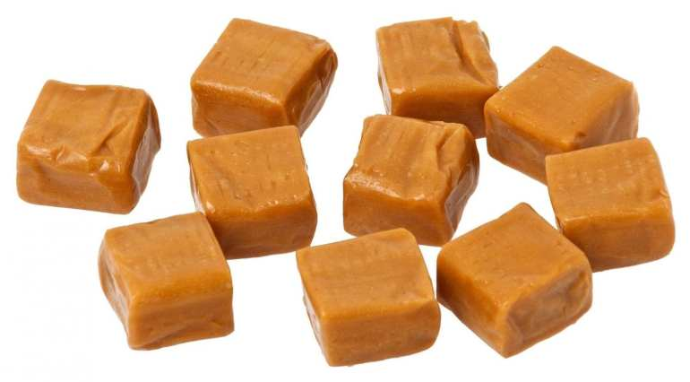 Cubes of caramel on a white background macro