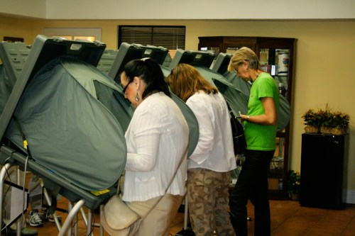 San Juan Capistrano voters cast their ballots via electronic vote at the Del Obispo Terrace Senior Center during the 2012 election. Photo: Kevin Dahlgren
