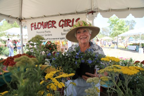 Joanie Espy, a vendor at the Eco Xpo, shows off some of her flowers. Photo by Brian Park