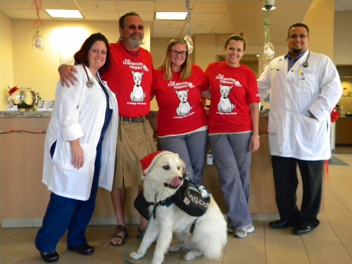 Veterinary Medical and Surgical Group staff members, including Dr. Heather Mineo and Dr. Marcos Unis, visit with Luke Robinson and his dog Indiana. The duo is walking 2,000 to promote awareness of canine cancer. Photo courtesy Lynnette Coverly.