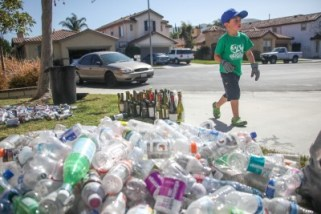 Six-year-old Ryan Hickman recycling at his San Juan Capistrano home. Photo: Allison Jarrell
