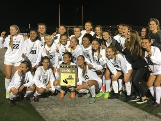 JSerra girls soccer team celebrates with the CIF-SS Division 1 championship plaque after win over Santa Margarita on March 3. Photo: Zach Cavanagh