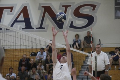 St. Margaret's senior Gavin Clarke sets a ball in the Tartans' opening round win over Godinez. Photo: Zach Cavanagh