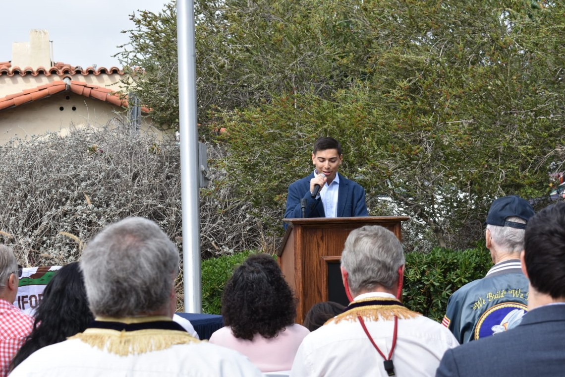 Jake Griffith, son of developer Bill Griffith, speaks during a ceremony where two of his family's buildings are recognized. Photo: Alex Groves