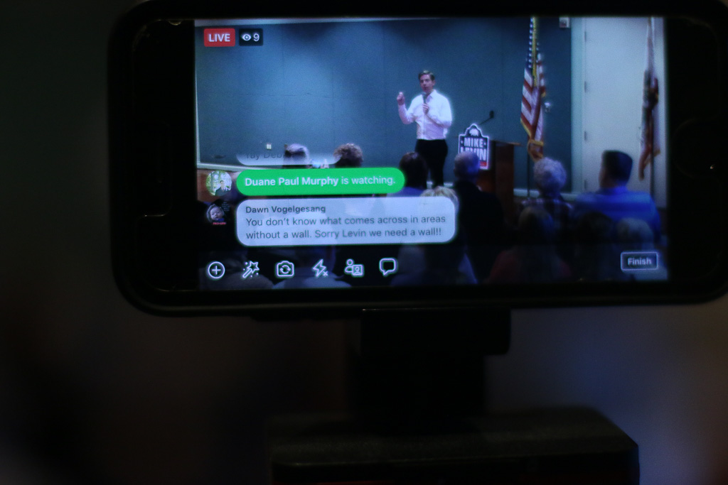 During the live stream coverage of Rep. Mike Levin's town hall meeting, one Facebook user chimes in on the freshman congressman's criticism of President Donald Trump's emergency declaration to fund his $5.7 billion proposal to build a border wall. Photo: Eric Heinz
