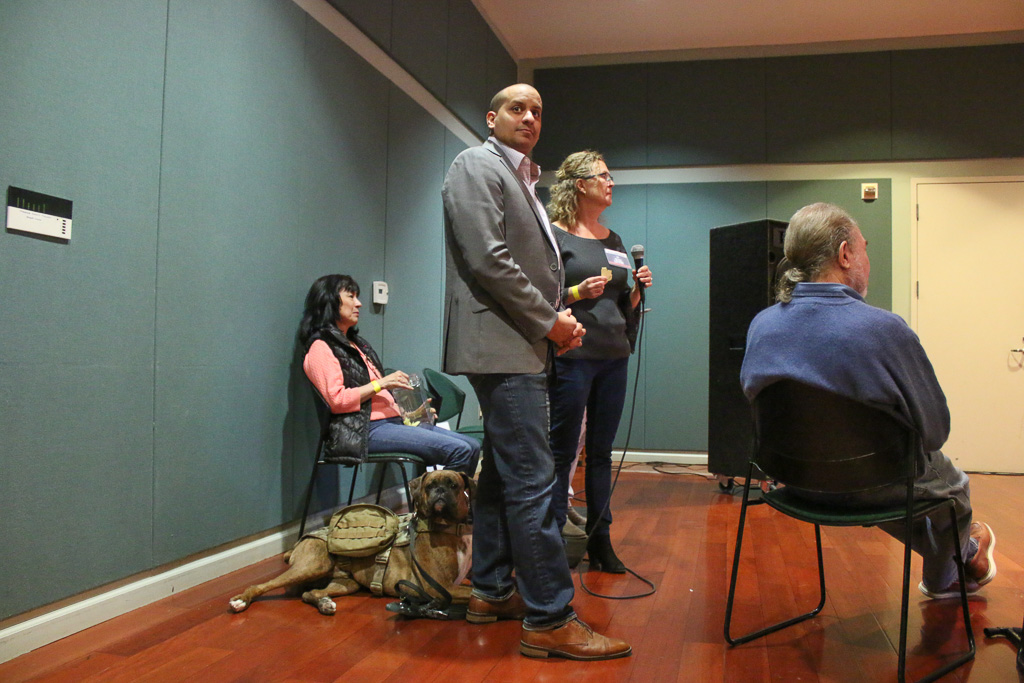 Juan Valdez, a veteran and San Juan Capistrano resident, waits for his turn to ask Rep. Mike Levin a question during a town hall meeting. Photo: Eric Heinz