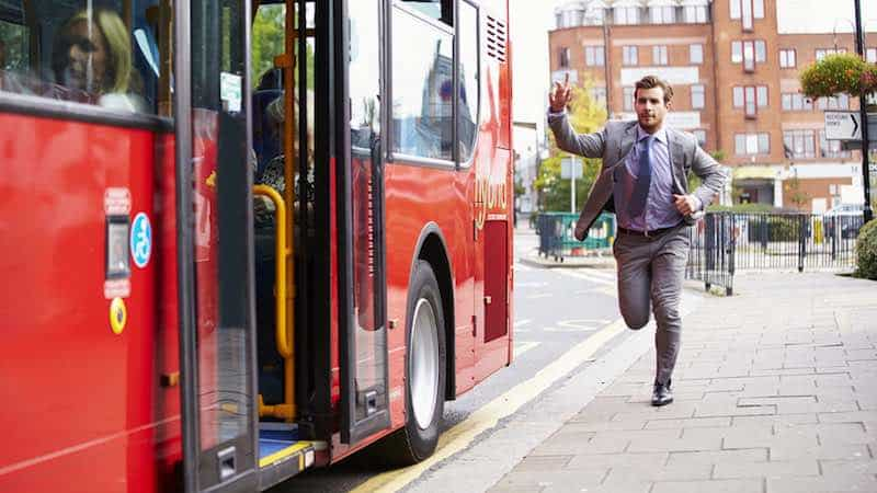 Man running to catch a bus