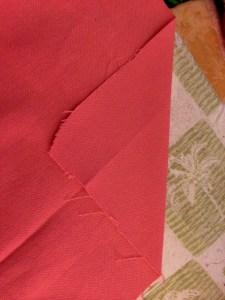 diagonal fold on bottom hem