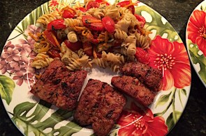 Carrot and tomato pasta with grilled sausage