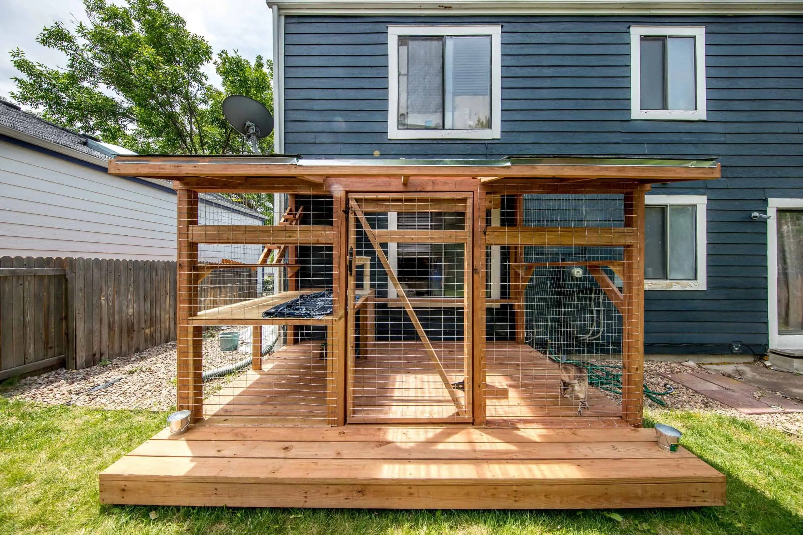the boulder catio with deck by cat topia