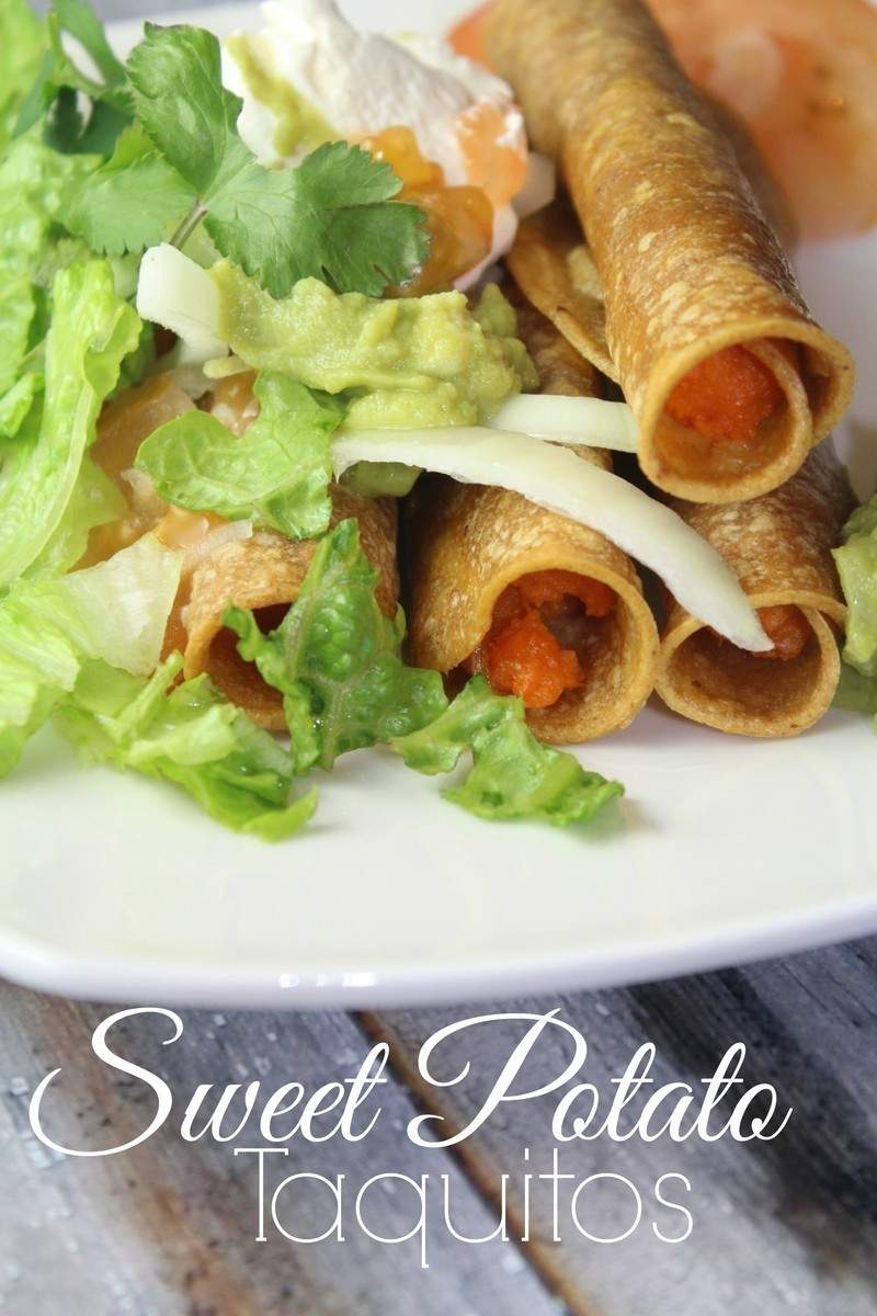 Baked sweet potato taquitos that are delicious when topped with shredded lettuce, tomatoes, sour cream and guacamole. #meatless #sweetpotato #mexican