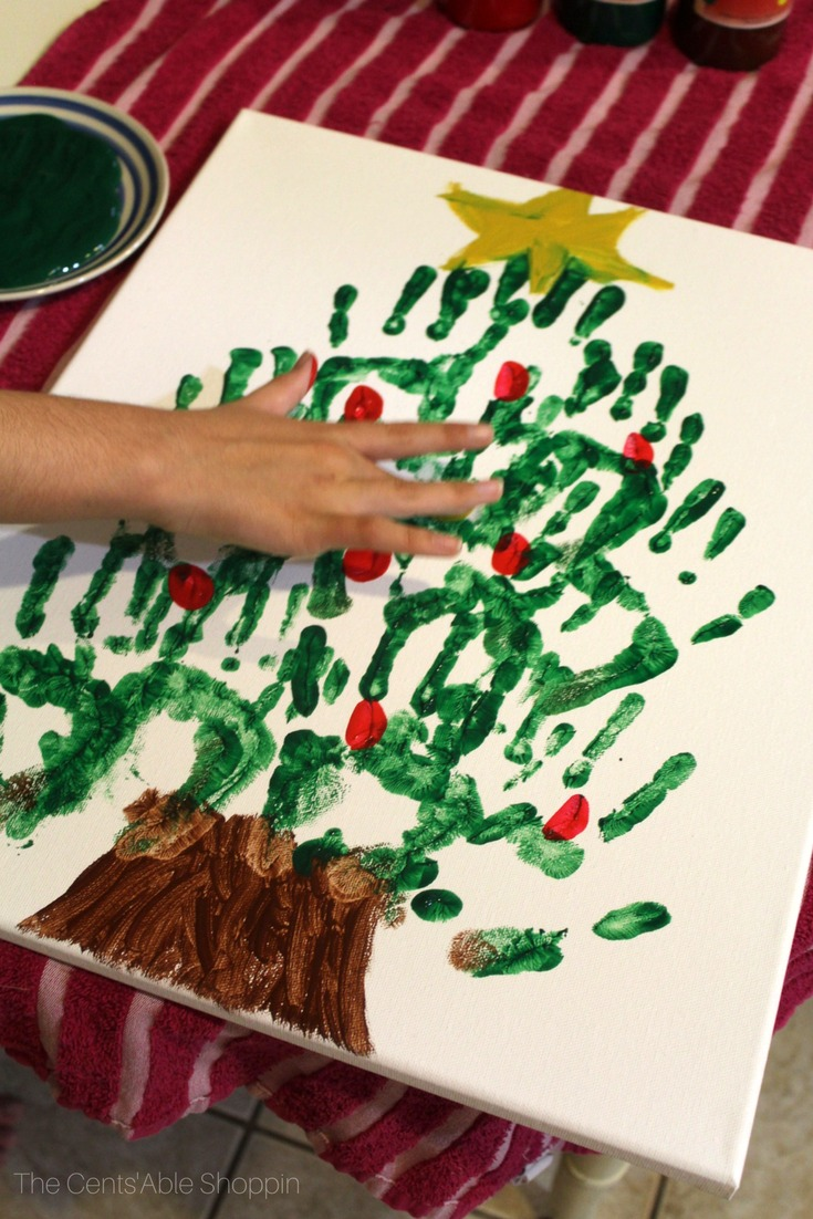 Gather the kids together for this fun and easy Christmas tree handprint canvas art that they can make in just a matter of minutes! #christmas #canvas #handprint #craft #christmastree