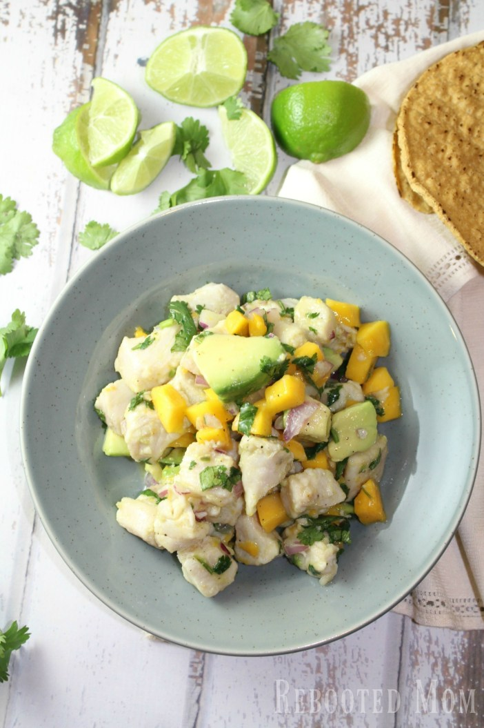 Tropical Mango Ceviche - Rebooted Mom || This tropical mango ceviche uses lemon or lime juice with mahi mahi fillets to cook the fish (through the acidic marinade) in just under 45 minutes. It's delicious!