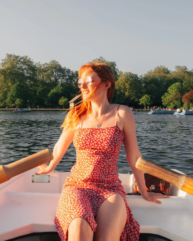 Travel blogger in a row boat on the Serpentine in Hyde Park