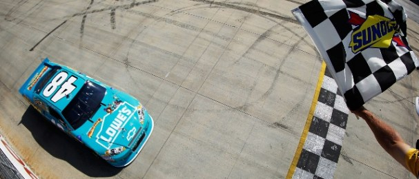 Jimme Johnson comes under the checkered flag for his second win in three races (Photo Credit: Todd Warshaw/Getty Images)