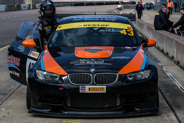 Kevin Clarke pushes his E92 M3 down pit lane after stopping in the wrong pit box.