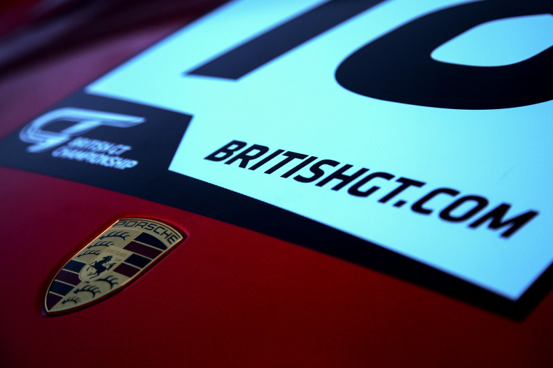 The Porsche logo on the #18 WPI Motorsport Porsche 911 GT3 Cup entered into the 2018 British GT Championship