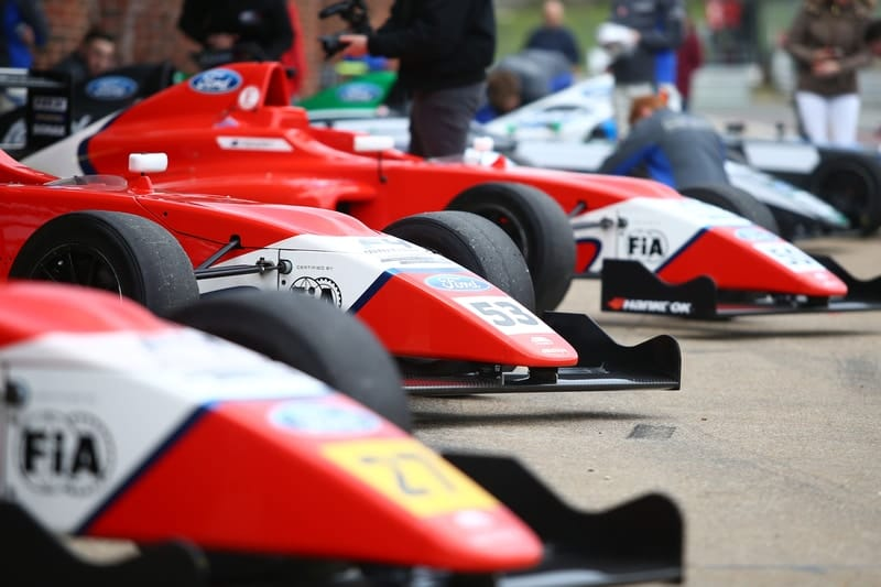 British F4 cars in the pit-lane.
