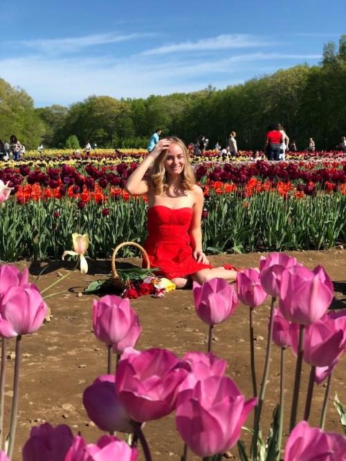 Girl sitting in flower field