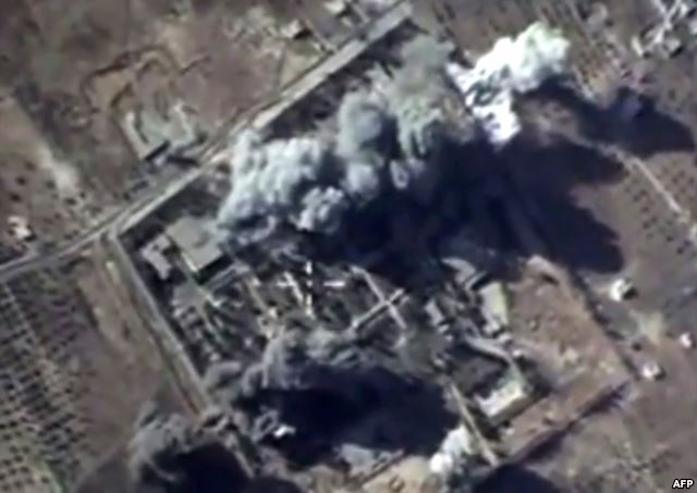 A video grab made on Oct. 12, 2015, shows an image taken from a footage made available on the Russian Defence Ministry's official website, purporting to show explosions after airstrikes carried out by Russian air force.
