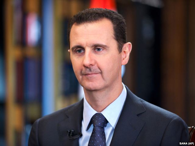 FILE - Syrian President Bashar Assad speaks during an interview with Venezuela's state-run Telesur network, in Damascus, Syria.