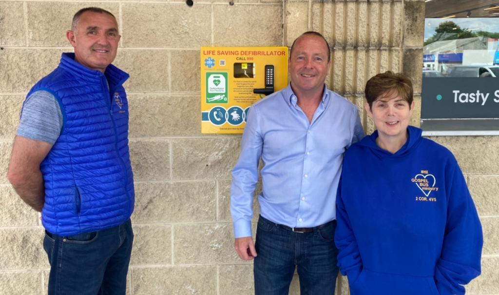 Gospel Bus Ministry hands over life-saving defibrillator to McCools Centra Ballymena