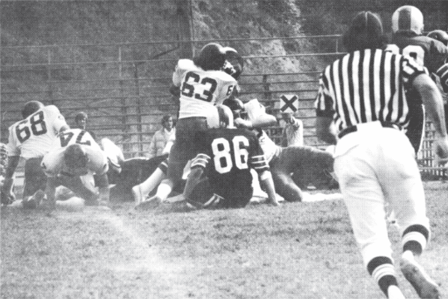 The CCC defense stuffs the Walla Walla offense during a game in 1976.