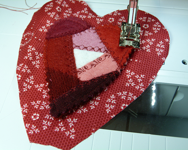 8 sew felt onto heart