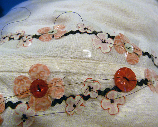 sew on buttons and flowers