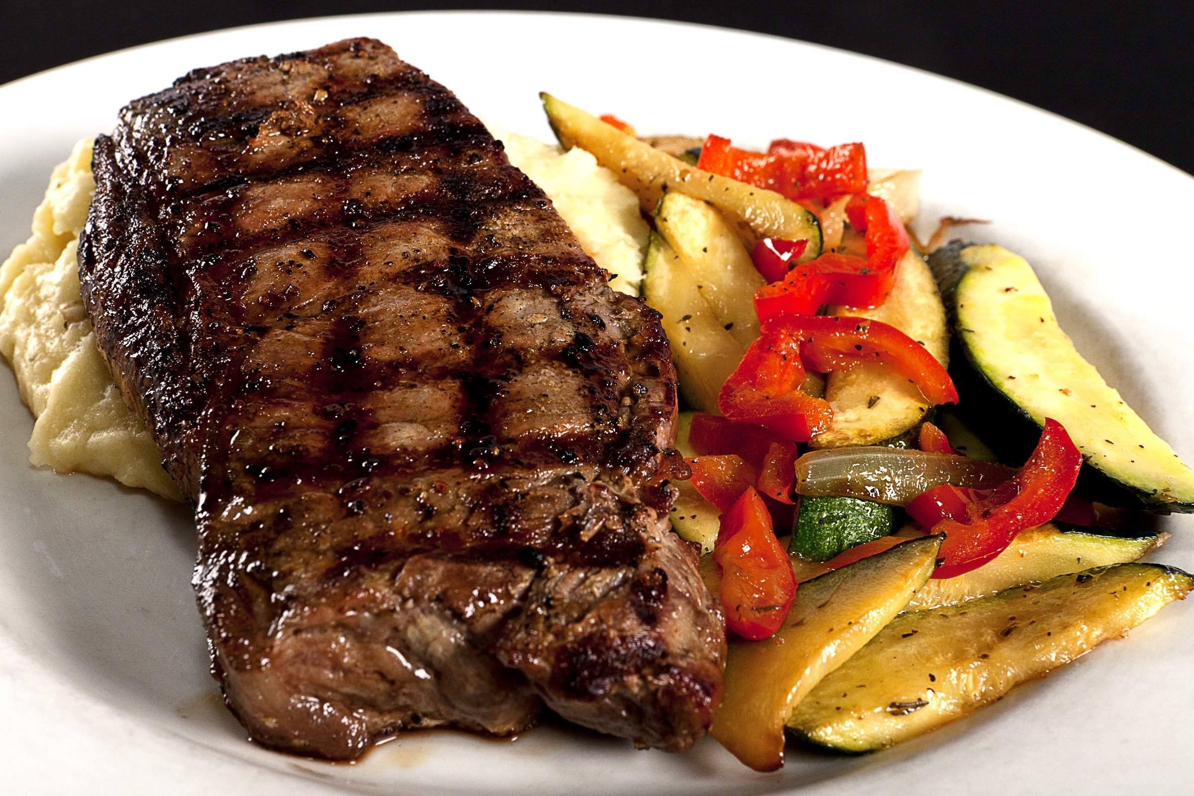 Montana Steakhouse the 8 ounce New York Strip served with salad and your choice of two sides at The Club Tavern and Grill Bozeman Montana