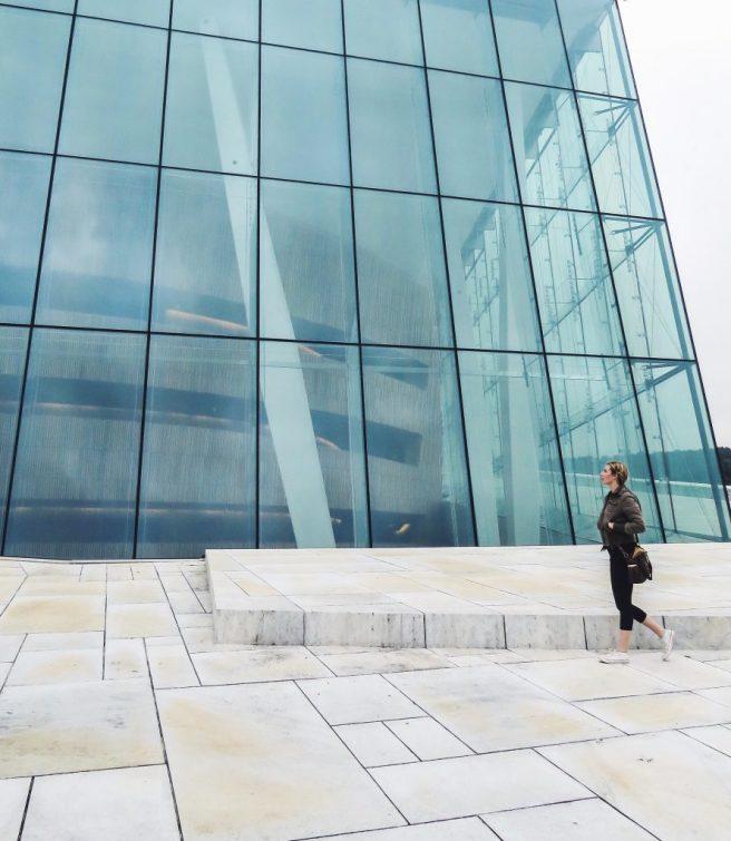 48 Hours in Oslo - Girl walking in front of Oslo Opera house in Norway