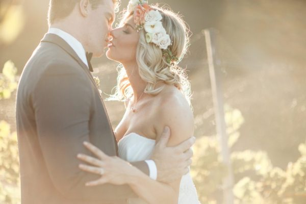 beautiful shot of newlyweds kissing in vineyard at wedding SoCal; 2016 Sucked and This is What I Learned From It