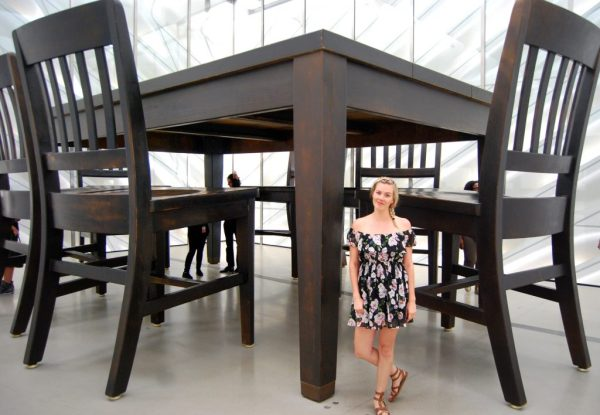 Everything You Need to Know When Visiting The Broad; girl in front of large table and chairs at the broad