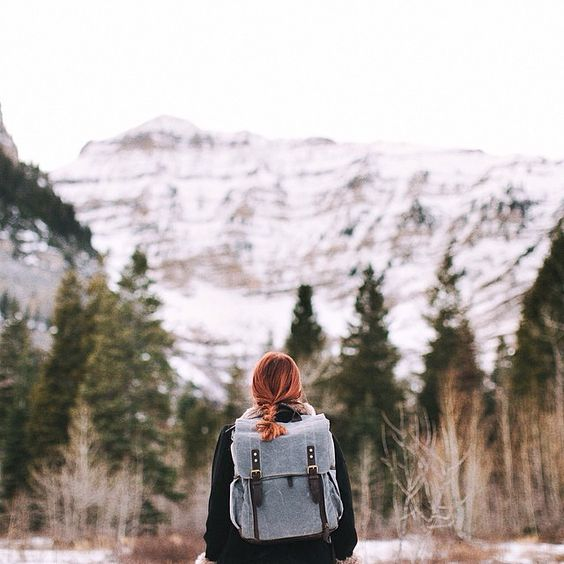 Best Travel Gift Ideas; girl hiking with ona backpack
