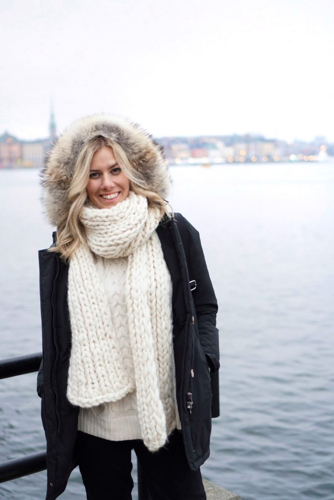 Winter Wonderland Lookbook; blonde girl in Europe chunky knit scarf and Woolrich parka