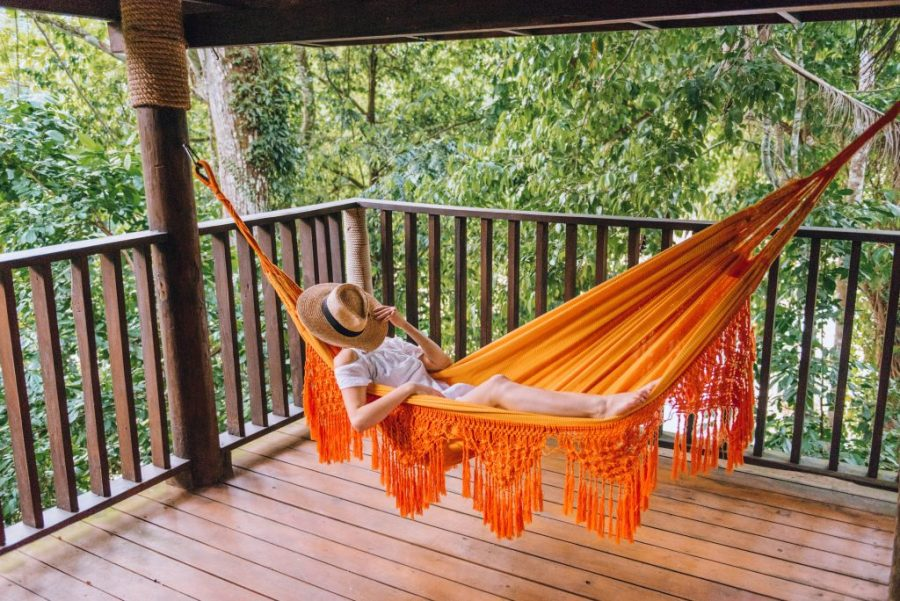 southwest Dominican Republic; girl laying in a hammock; Rancho Platon treehouse