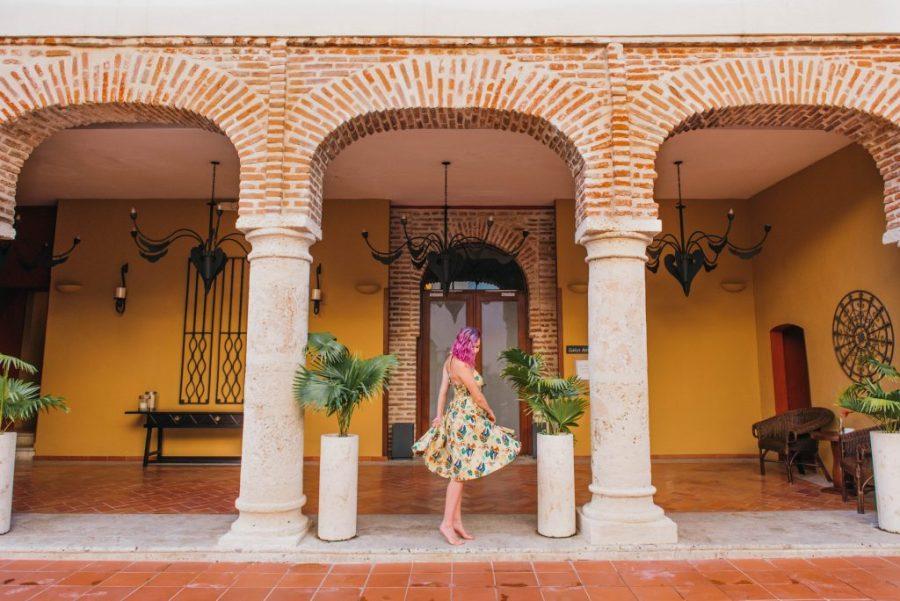 24 Hours in Santo Domingo; Hodelpa Nicolás de Ovando interior red brick girl dancing in yellow dress
