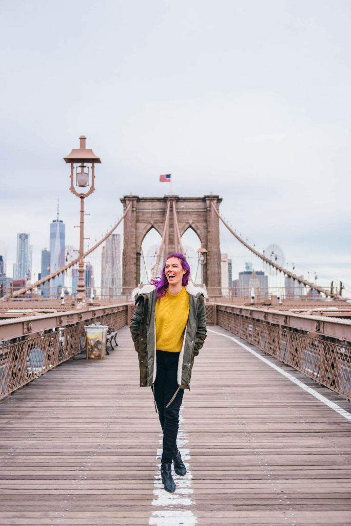 48 hours in New York; Girl walking across Brooklyn Bridge sunrise