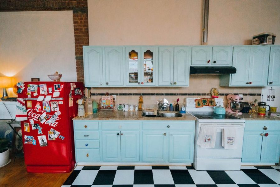 Staying at The Funky Loft in Brooklyn, New York; interior retro apartment details vintage kitchen blue and red retro fridge
