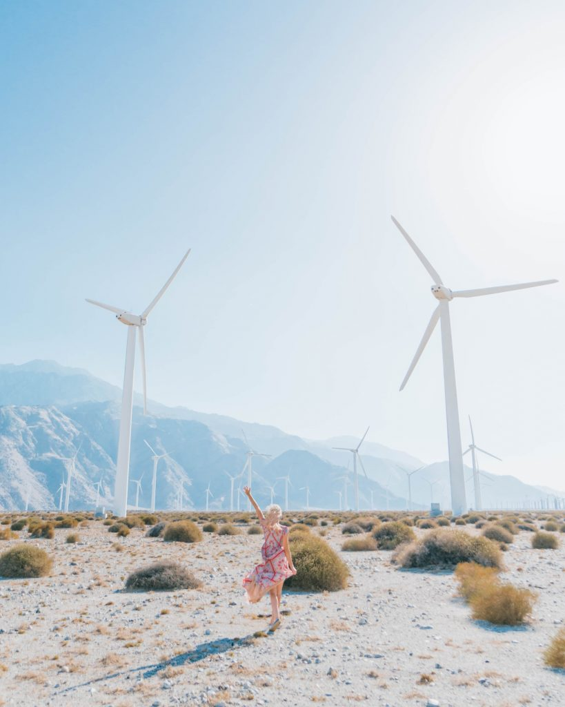 Best Photos in Palm Springs; girl in the windmill farm