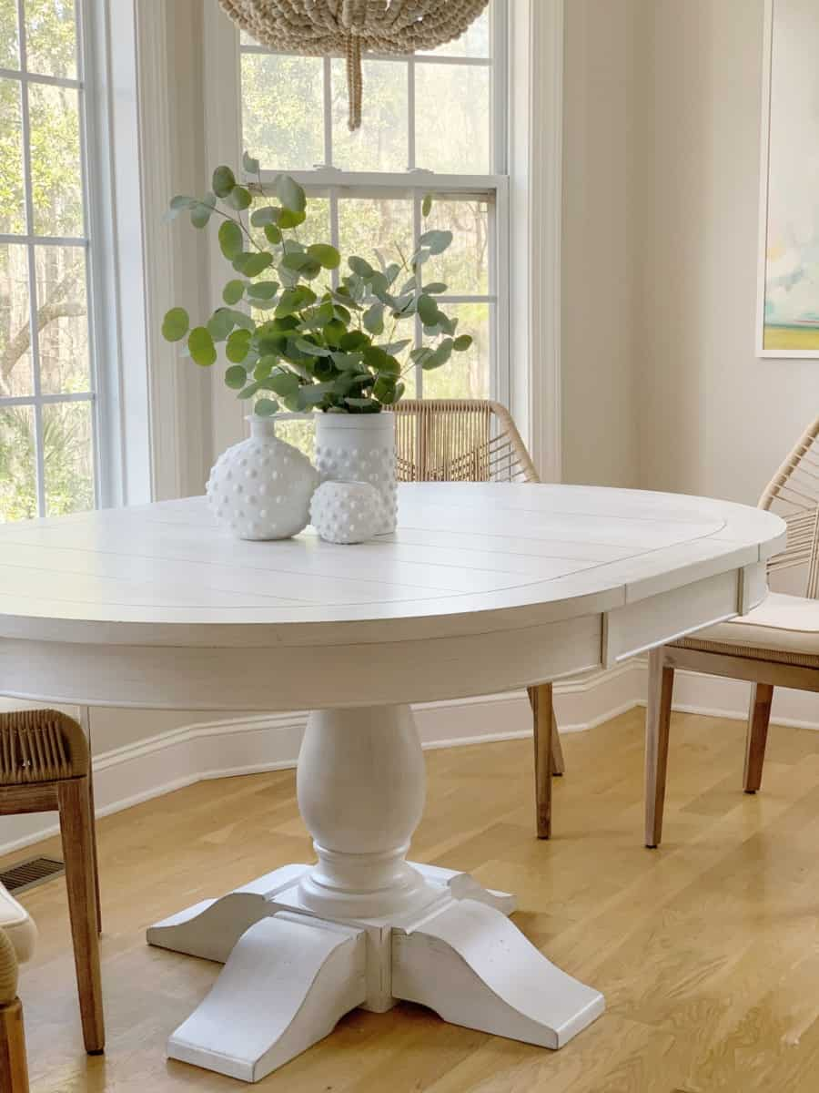 A review of our new white dining table with a pedestal that is extendable and is the perfect addition for our coastal home.