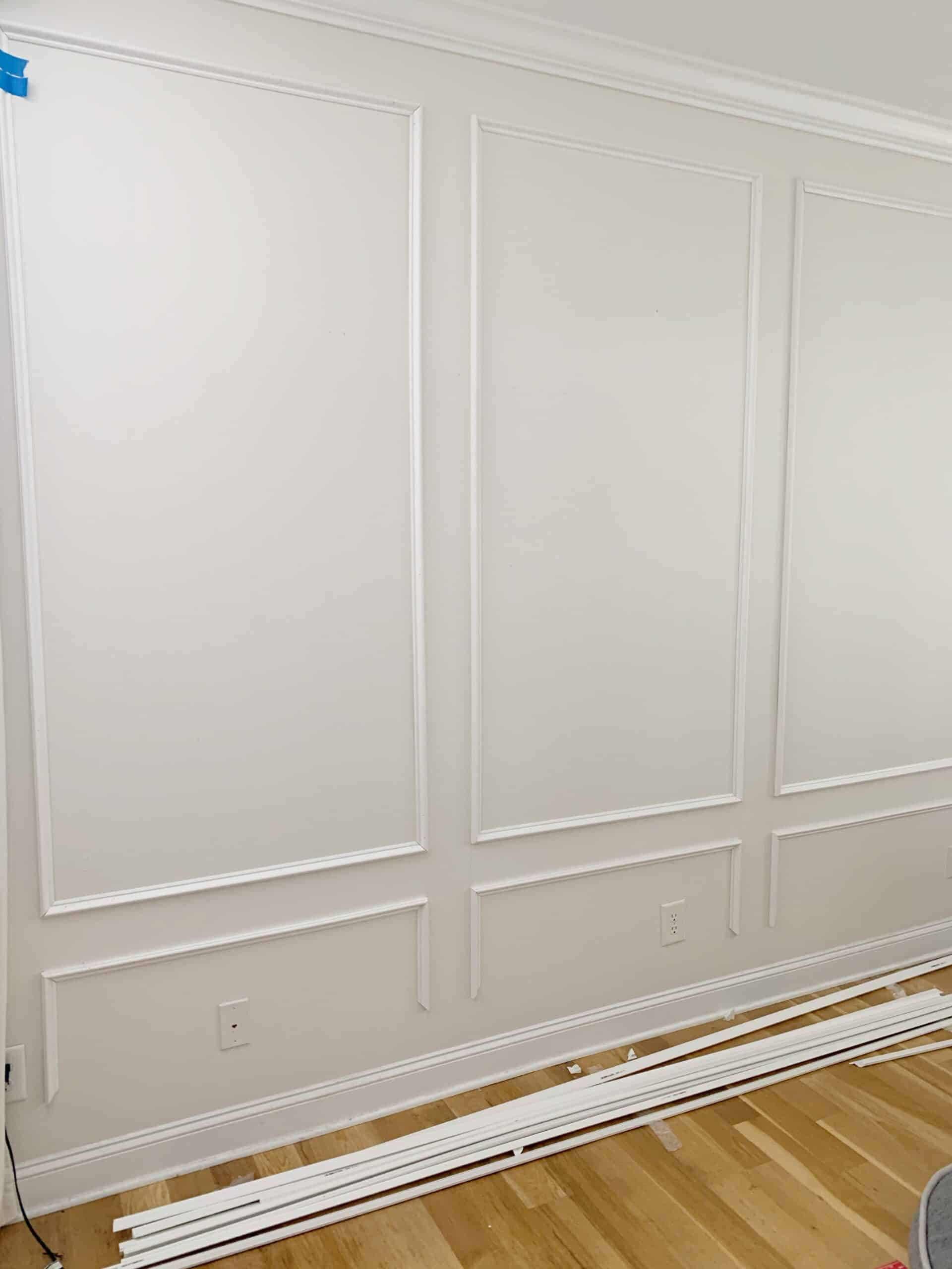 How to install picture frame molding, the easy way, using miter shears and PVC molding.  No saw required.  #millwork #molding #moulding #pictureframemolding #pictureframemoulding #pvctrim #pvcmillwork #walltrim #walltreatment