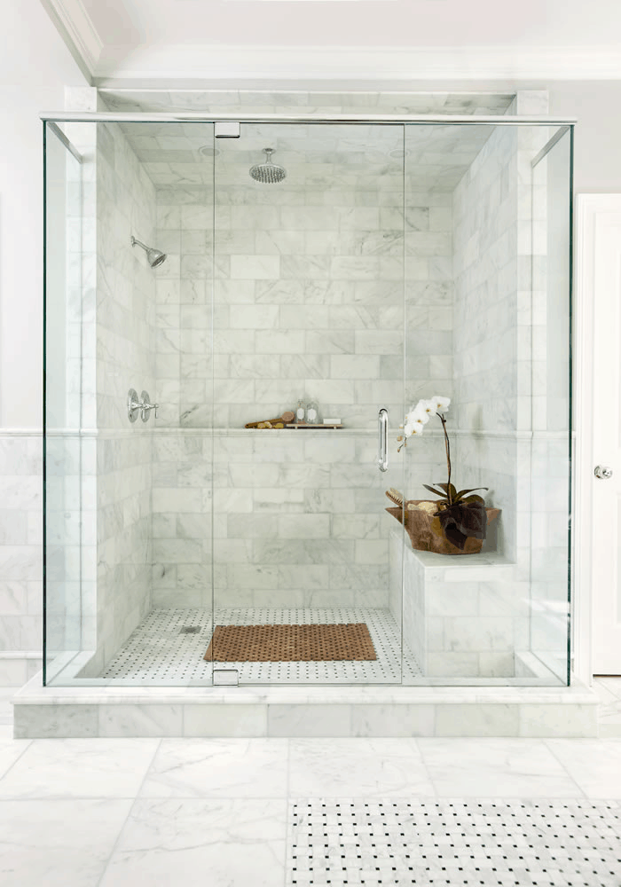 Different sizes and patterns of marble used in bathroom.