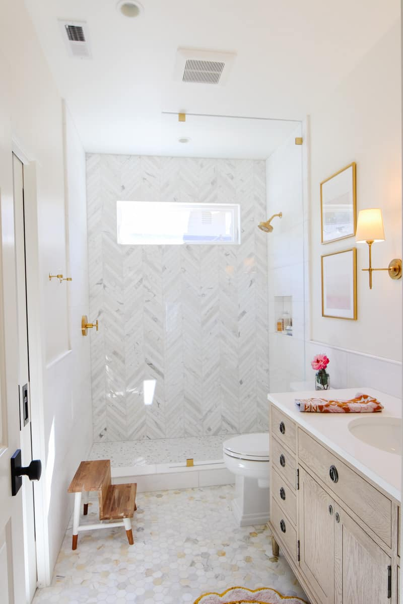 Marble patterns in shower and bathroom.