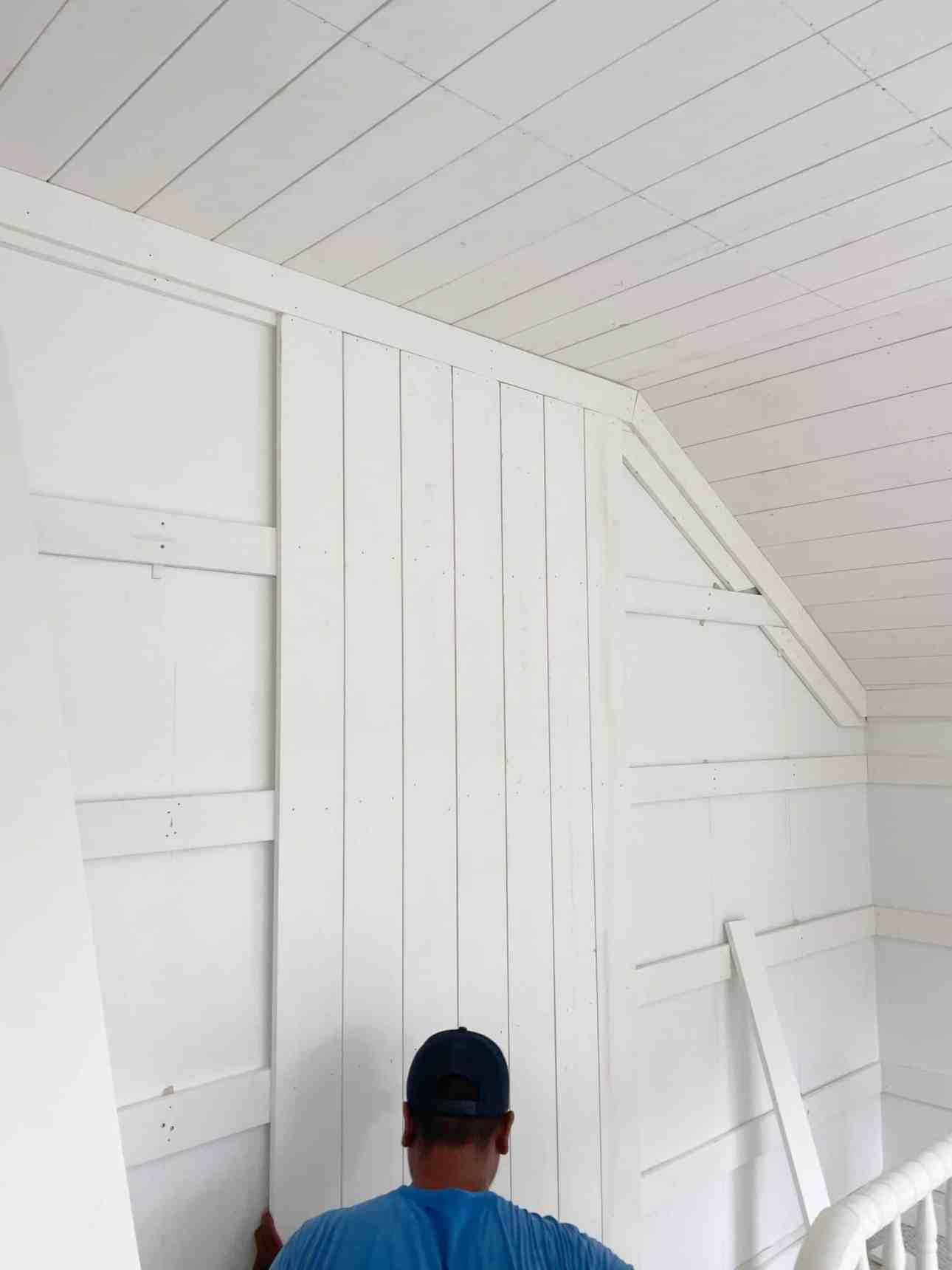 Room makeover installing vertical shiplap.