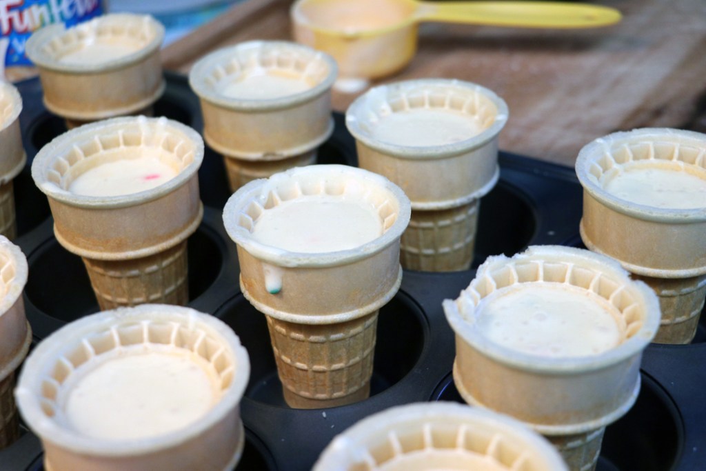 pour cake batter into the cones