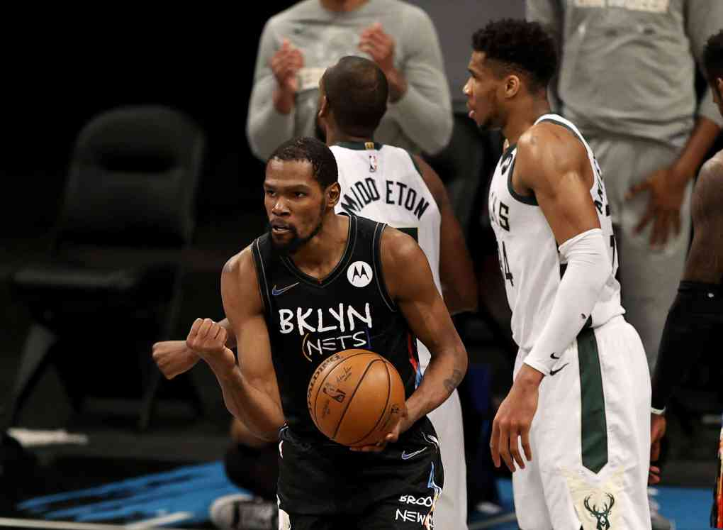Kevin Durant #7 of the NBA Brooklyn Nets celebrates after he drew the foul as Giannis Antetokounmpo #34 of the Milwaukee Bucks reacts in the fourth quarter during game 5 of the Eastern Conference second round at Barclays Center on June 15, 2021 in the Brooklyn borough of New York City.