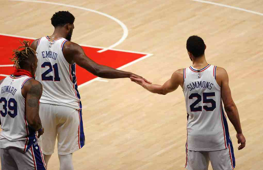 Joel Embiid #21 and Ben Simmons #25 of the Philadelphia 76ers react in the final minutes of their 127-111 win over the Atlanta Hawks in game 3 of the Eastern Conference Semifinals at State Farm Arena on June 11, 2021 in Atlanta, Georgia.