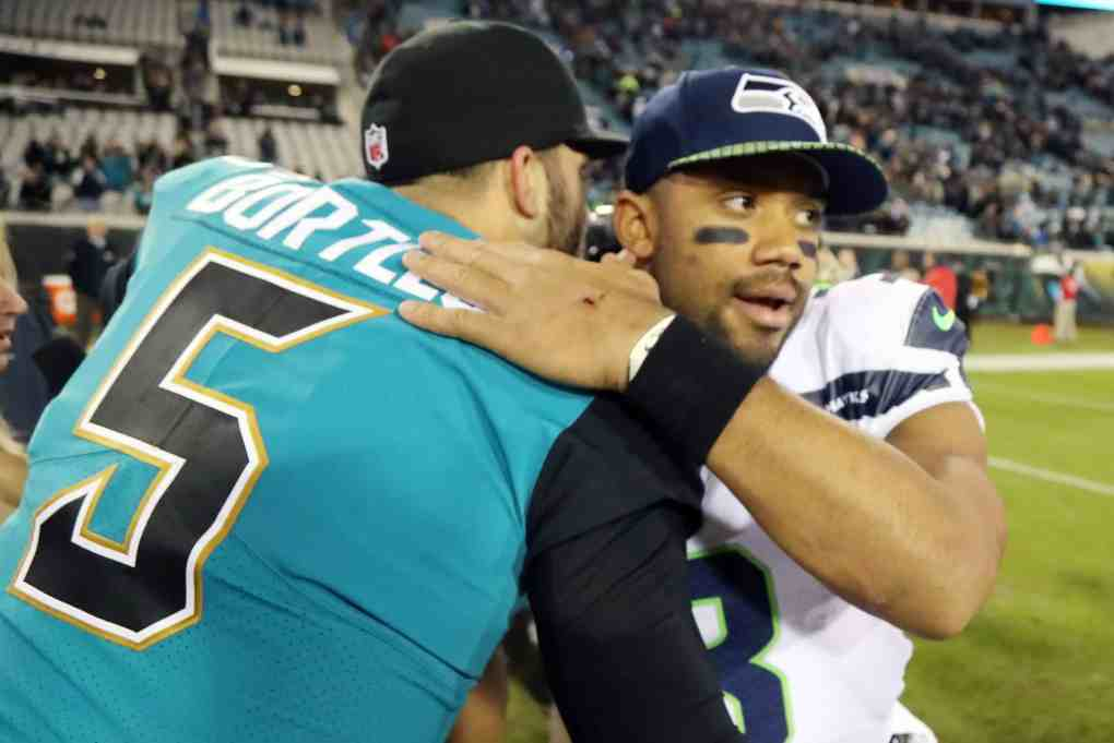 Blake Bortles #5 of the Jacksonville Jaguars greets Russell Wilson #3 of the Seattle Seahawks after the Jaguars defeated the Seahawks 30-24 at EverBank Field on December 10, 2017 in Jacksonville, Florida.