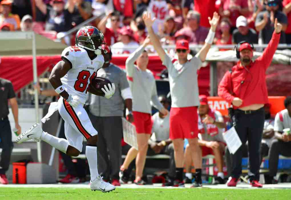 Antonio Brown #81 of the Tampa Bay Buccaneers runs to the endzone on a 62-yard touchdown pass from Tom Brady #12 (not pictured) against the Miami Dolphins during the second quarter at Raymond James Stadium on October 10, 2021 in Tampa, Florida.